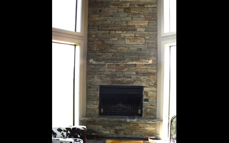 Traditional Schist chimney in tight stack with  large natural faced stones